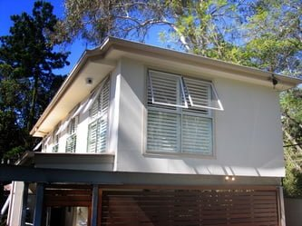 Outside view of a house installed with security window shutters