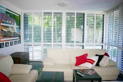 Aluminium plantation shutter installed in the living area to enhance the look of the room