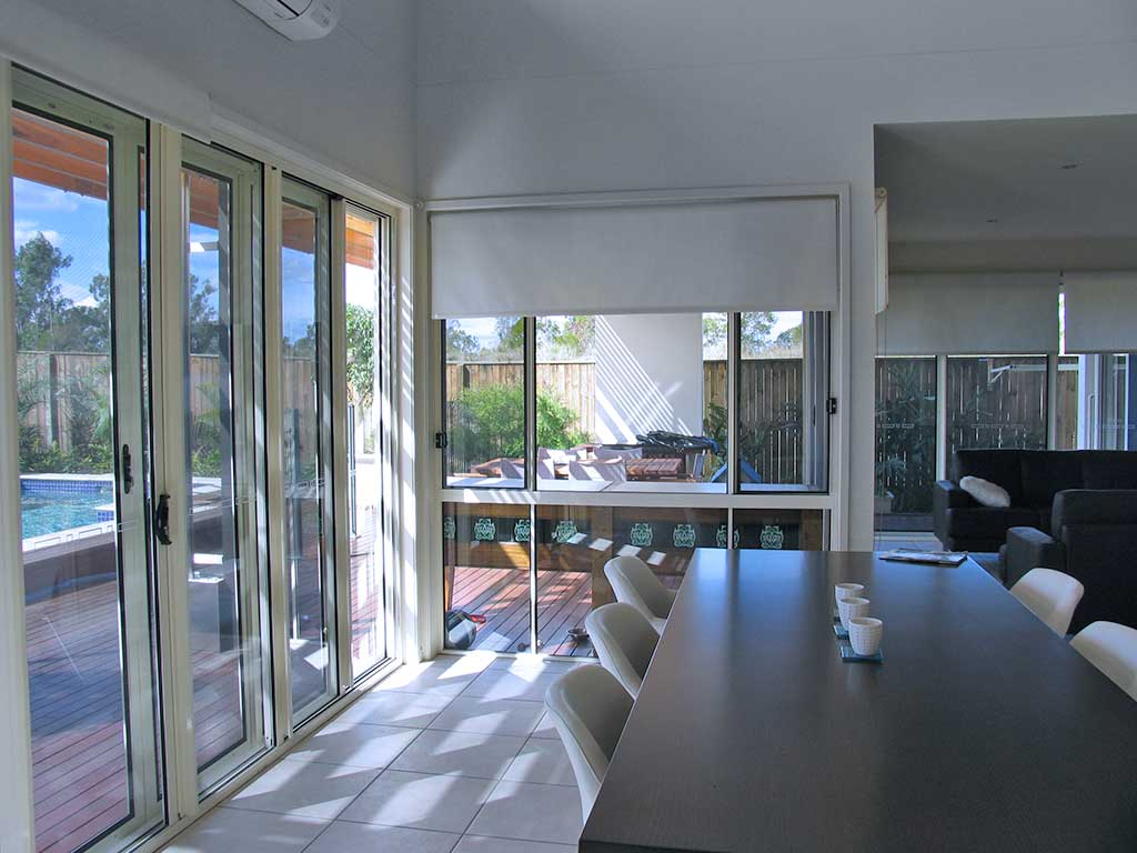 A living room installed with crimsafe door screens