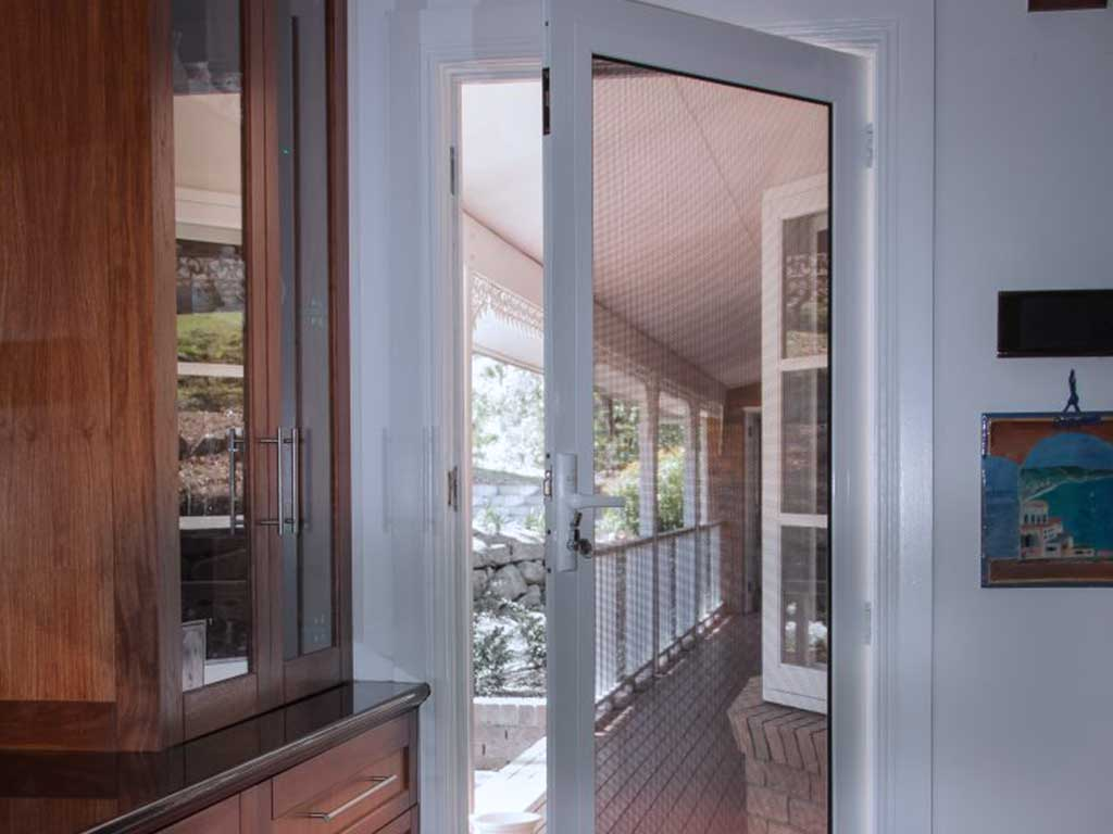 Open door installed with crimsafe door screen
