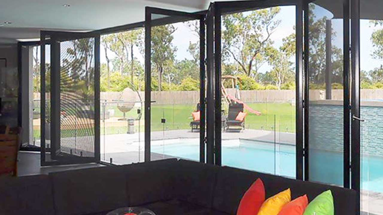 Crimsafe doors installed at the entrance of pool area