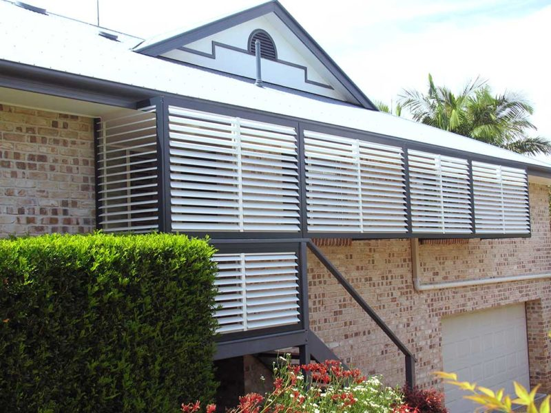 Privacy screen shutters installed outside the balcony of two-storey house