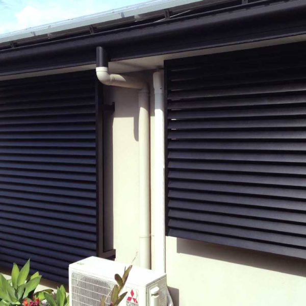Backside of store with black aluminium privacy screens shutters