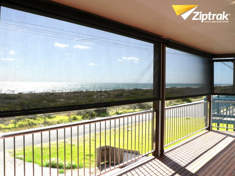 Balcony view of half open Ziptrak Sunscreen Mesh Blinds