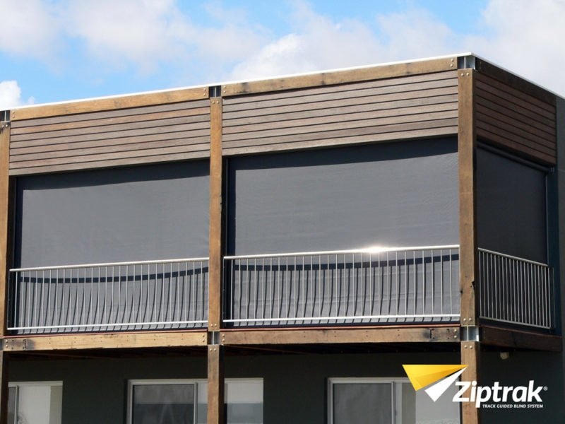 Balcony covered with Ziptrak outdoor blinds