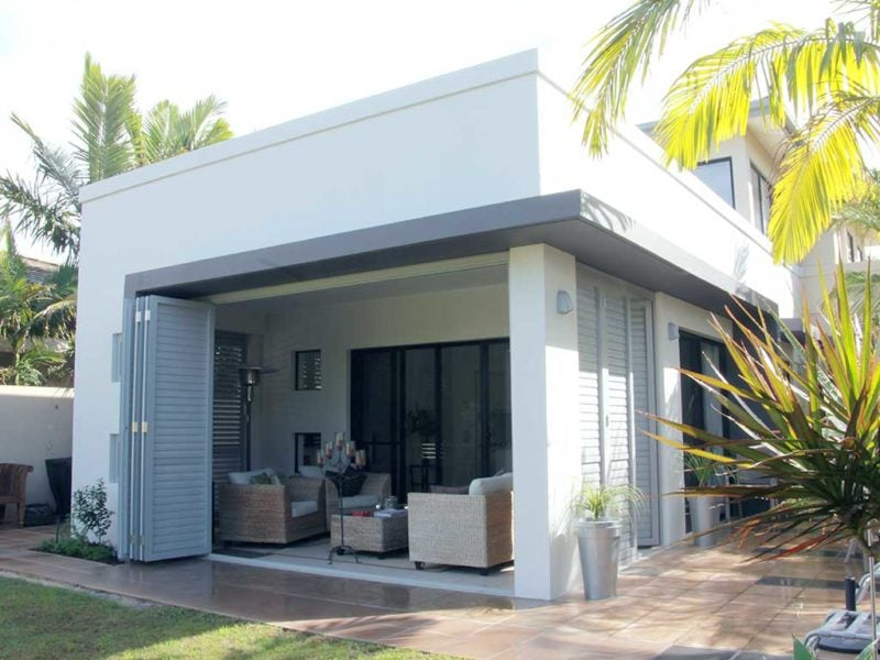 A house with open bi-fold balustate doors with interior view
