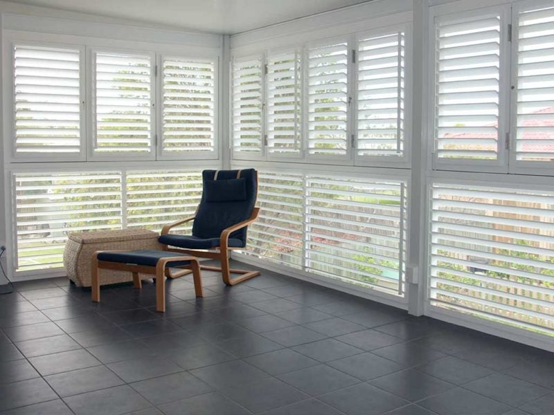View of balcony sitting area installed with lockable plantation shutters
