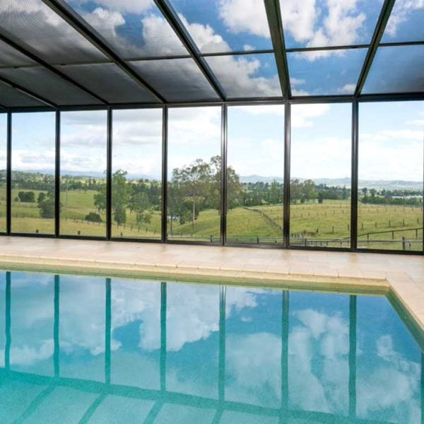 A swimming pool area with crimsafe screens