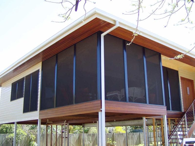 A house windows with black crimsafe protection screens