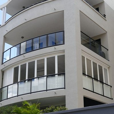 Three storey building installed with white aluminium shutters
