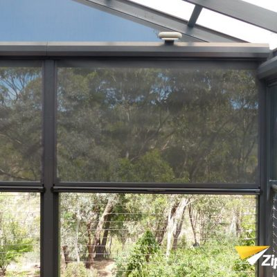 Rooftop of house installed with ziptrak sunscreen mesh blinds