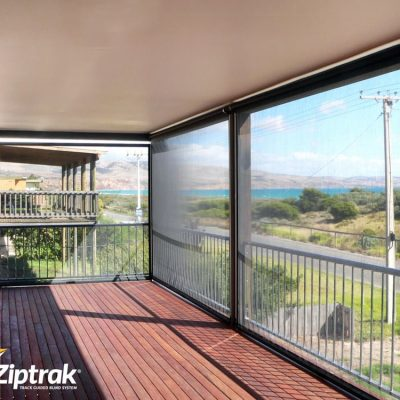 Side view of balcony with Ziptrak sunscreen mesh blinds