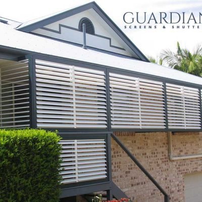 Aluminium privacy shutters installed outside the house for protection with Guardian Screens & Shutters logo