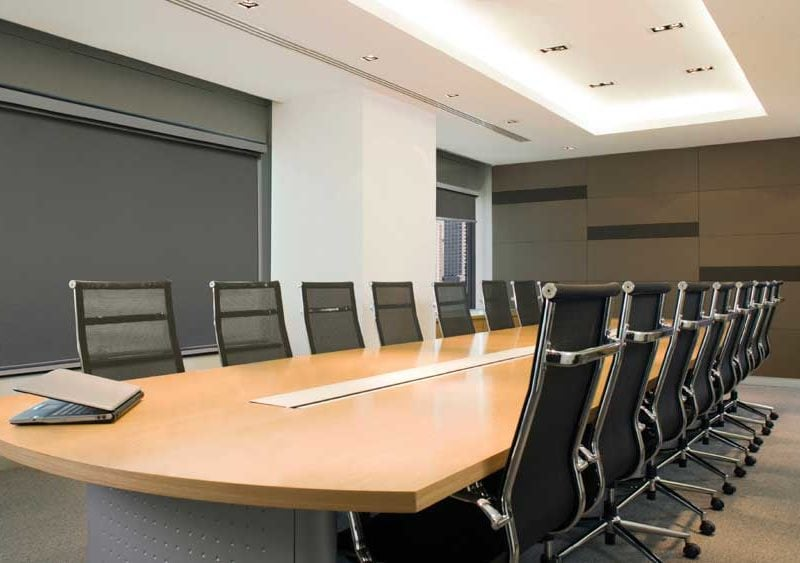 Modern furnished empty conference meeting room with black out window blinds